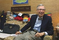Fred Rogers, 73, relaxes in his Family Communication Inc. office in Pittsburgh earlier this month.  Photo/Gary Tramontina